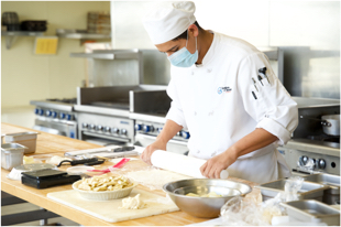 Chef wearing a mask