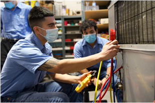 Students operating technical machinery