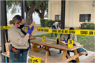 Woman standing in front of police tape
