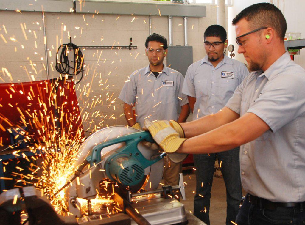 Men using a saw