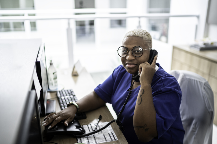 Person at a desk on the phone