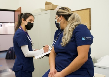 Medical students practicing a routine appointment
