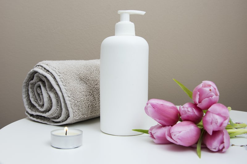 Lotion, towel, candle, and flowers
