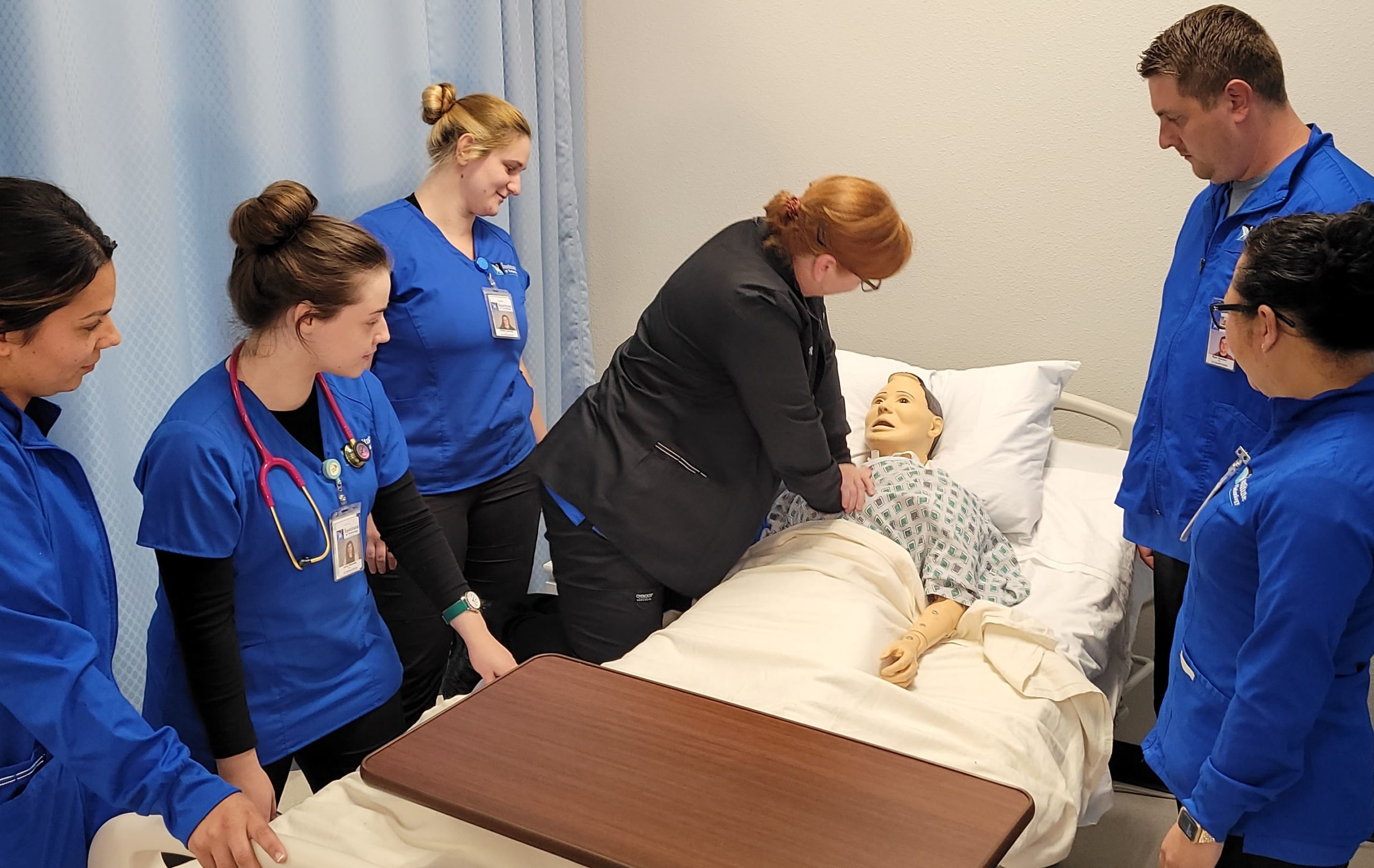 Instructor demonstrating CPR for students