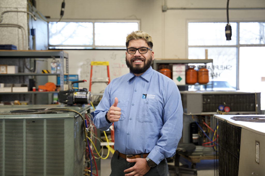 HVAC student smiling and giving a thumbs up