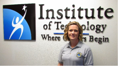 Woman standing in front of Institute of Technology sign
