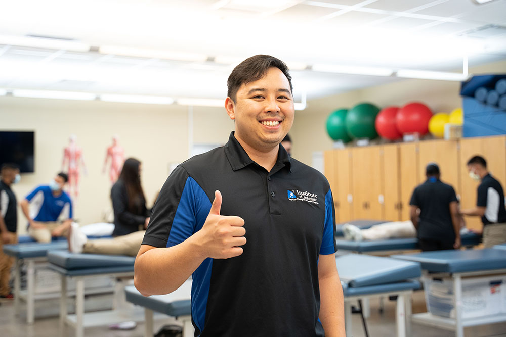 Physical therapy student giving thumbs up