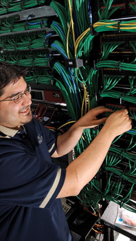 Man in front of wiring