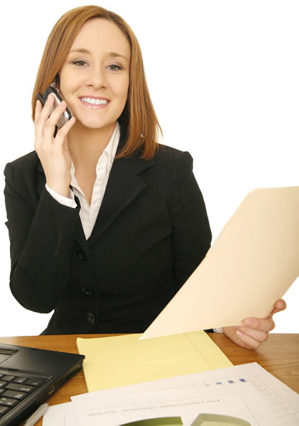 Woman in suit holding a cell phone